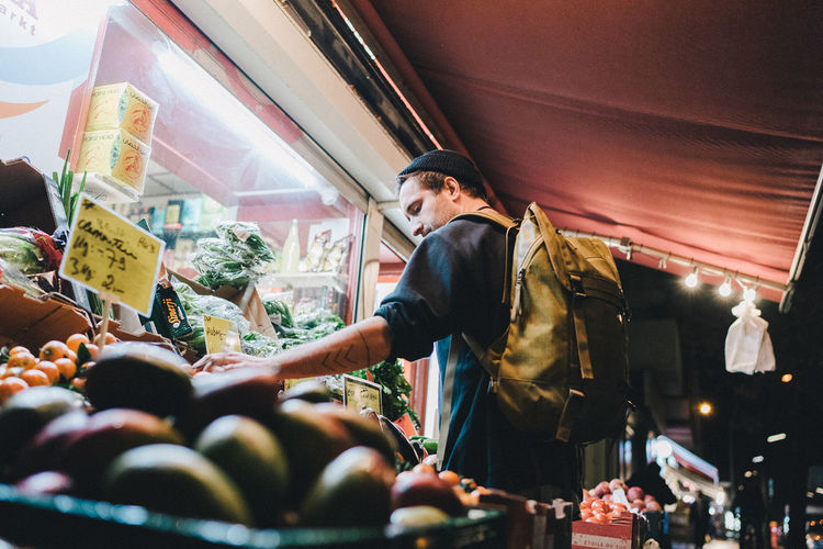 Low angle view of woman at market stall