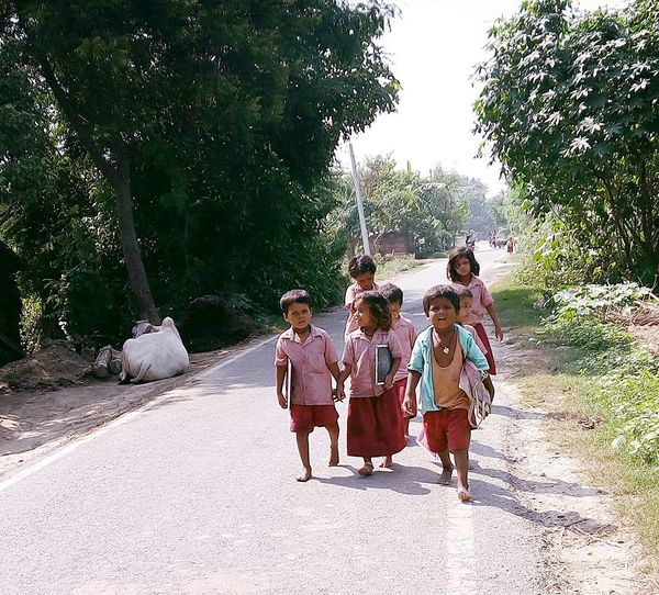 Children coming from school...zeal of developing Nation Happiness Traditional Clothing Childhood Memories Village Education Village Life Developing Country's Education Developing Country Group Of Happiness After School Children Returning Home Childhood Happiness ♡
