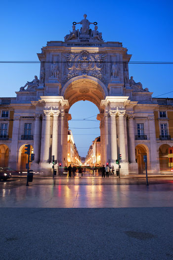 Rua Augusta Arch at night in Lisbon, Portugal. View from the Praca do Comercio Old Town Portugal Praça Do Comércio Sightseeing Square Arch Architecture Building Exterior Built Structure Capital City City Europe Evening History Landmark Lisboa Lisbon Monument Night Nightfall Rua Augusta Tourism Travel Travel Destinations Triumphal Arch
