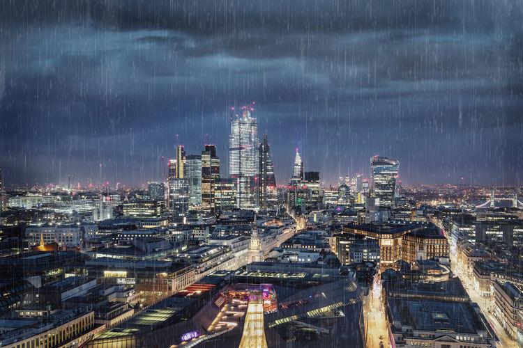 Illuminated city during rainy season at night
