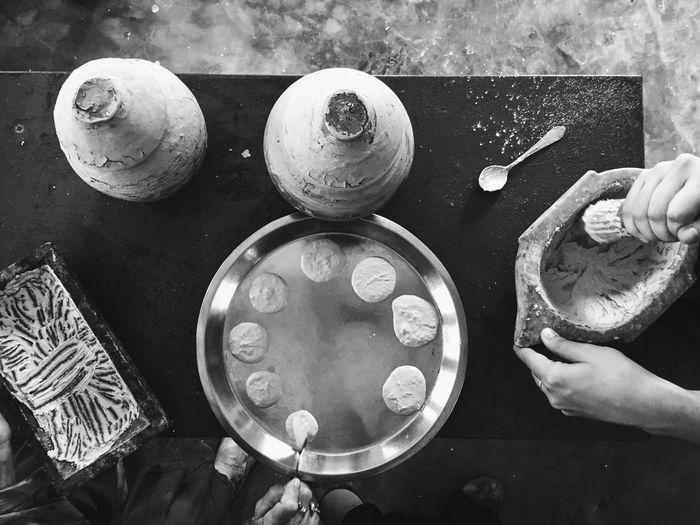 Cropped image of people preparing food on table