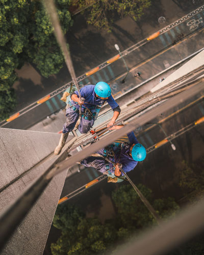 Day Work Adult Adventure Climbing Hanging Headwear Helmet Manual Worker Men Occupation One Person Outdoors Protective Workwear Real People Rope Safety Skill  Sports Helmet Working Young Adult