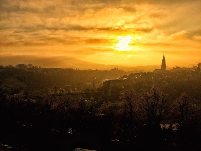 Let's start the new year with sunshine and happiness! ☀️ Switzerland Sunlight Bern 2017 New Year Sunset Tree Architecture Sky Building Exterior Built Structure Nature Cloud - Sky No People City Beauty In Nature Outdoors Cityscape Dramatic Sky Scenics Day First Eyeem Photo