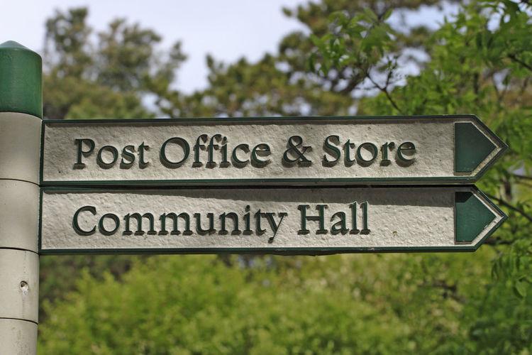 Post office sign Community Office Post United Kingdom Arrow Symbol Communication Day Direction Directional Sign Guidance Guidepost Hall Information Information Sign No People Outdoors Outside Plate Post Office Road Sign Sign Signboard Signpost Text Uk