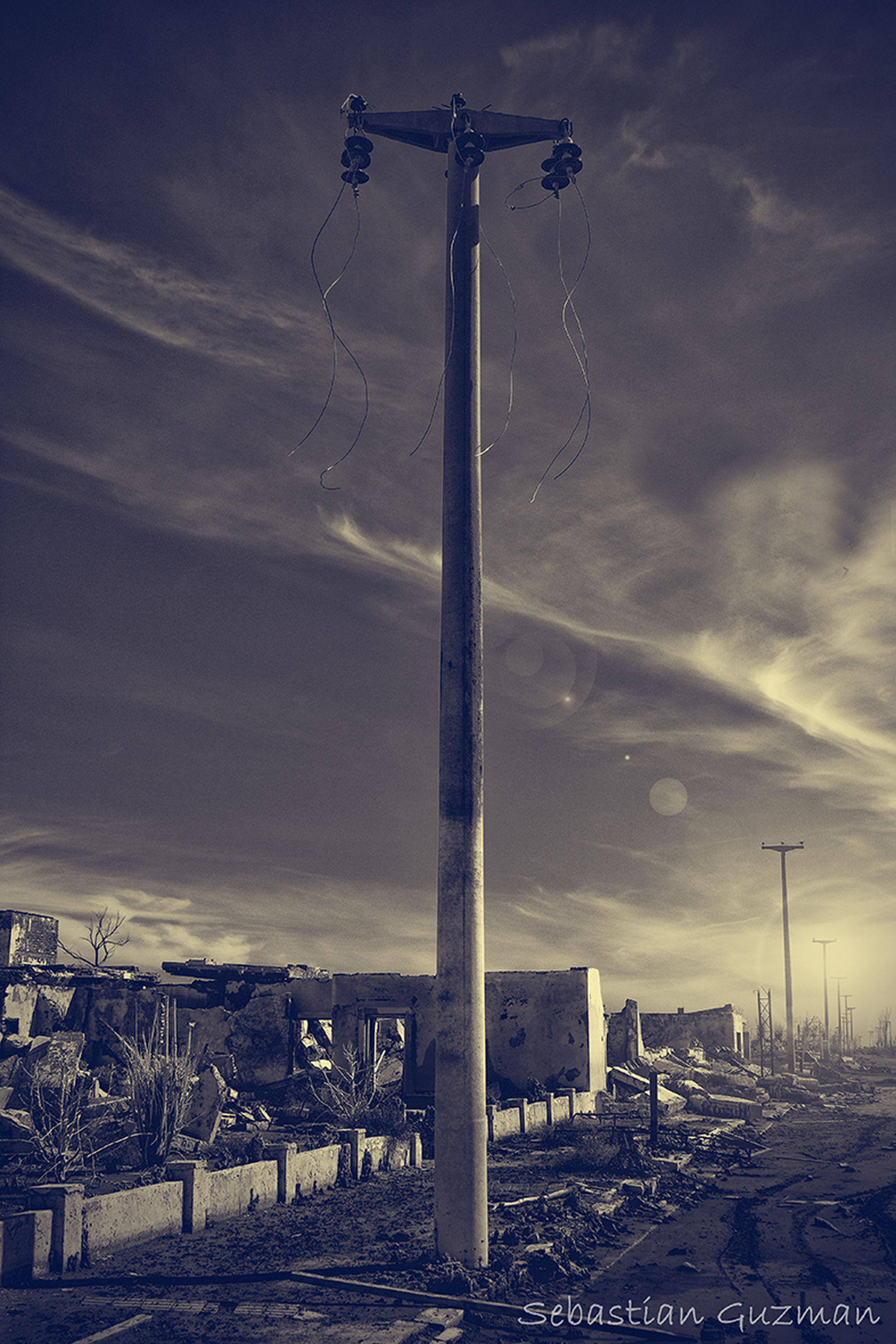 sky, cloud - sky, built structure, architecture, building exterior, cloudy, fuel and power generation, communication, weather, low angle view, outdoors, street light, no people, overcast, cloud, day, pole, dusk, technology, electricity