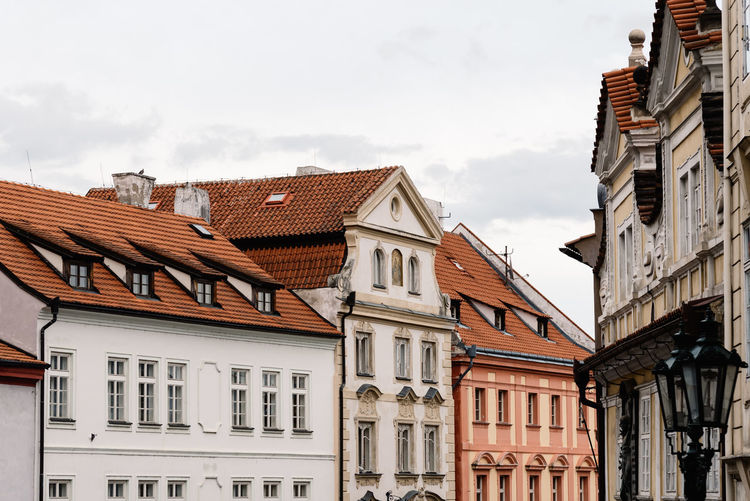 Mala Strana district in Prague Czech Republic Low Angle View Mala Strana  Travel Architecture Brown Building Building Exterior Built Structure City Cloud - Sky Day House Low Angle View Nature No People Outdoors Residential Building Residential District Roof Roof Tile Row House Sky Town Travel Destinations Window