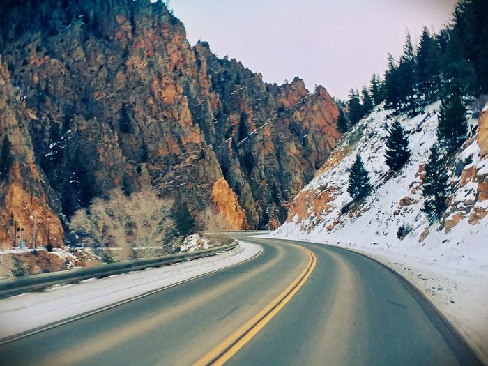 Road by mountain during winter