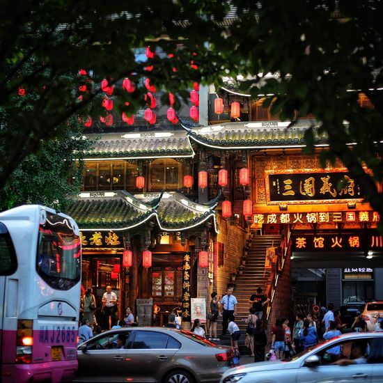 A lit up Chinese restaurant China Motor Vehicle Car Architecture Built Structure Mode Of Transportation City Decoration Night Group Of People Street