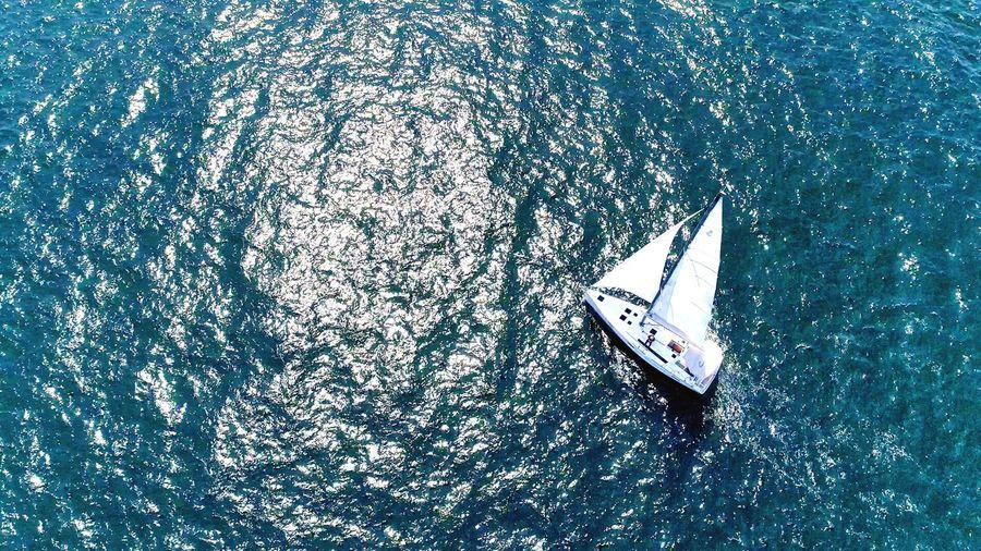 High Angle View Of Sailboat Sailing On Sea