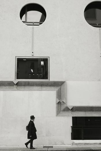 Woman Walking By Building