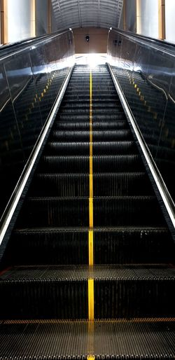 Low angle view of escalator in subway station
