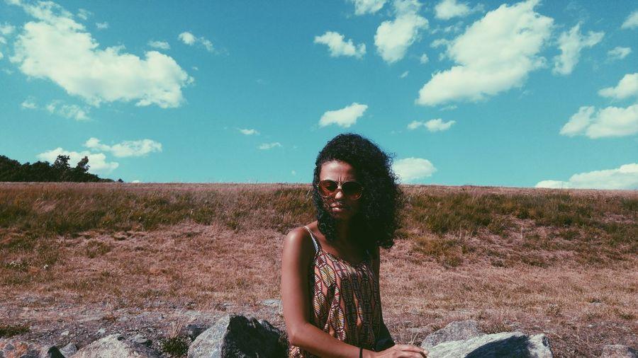 Woman Sitting On Field