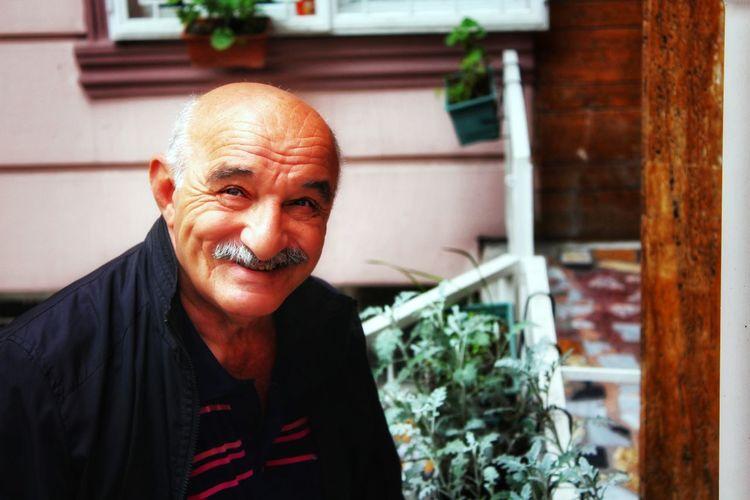 Portrait Of Smiling Mature Man At Backyard