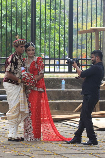Black Suit Day Fence Full Length Fun Kandy_town Marriage Photography Outdoors Photographer Portrait Red Colour Sri Lanka Traditional Costume The Street Photographer - 2016 EyeEm Awards
