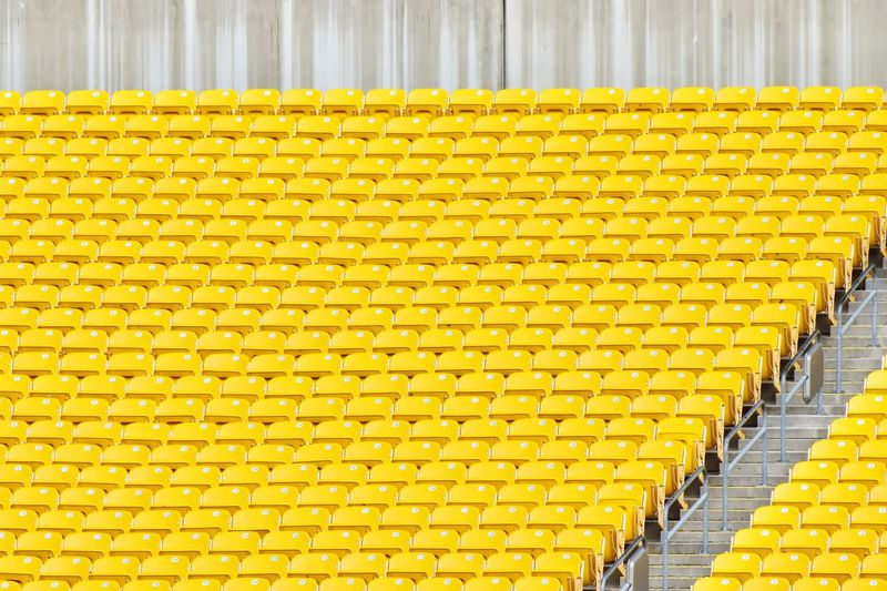 High angle view of yellow chairs in stadium