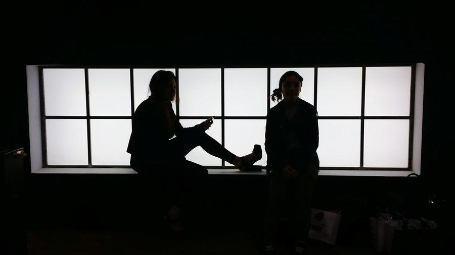 Silhouette of people in glass window
