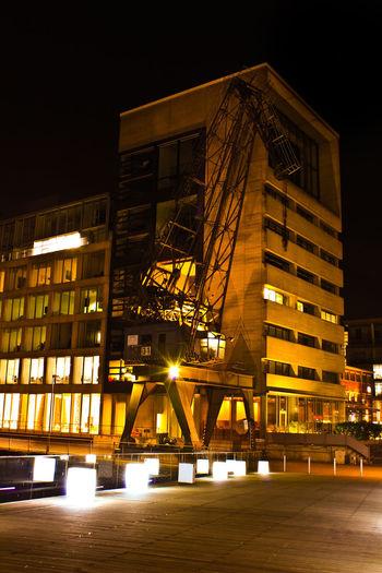 "Crane at ""Medienhafen"" Düsseldorf Cranes Gooftroop2 Düsseldorf Medienhafen Nightlights Düsseldorfer Hafen Architecture Night Illuminated Skyscraper Built Structure Building Exterior Cityscape City Modern Urban Skyline Business Finance And Industry Bridge - Man Made Structure Outdoors"