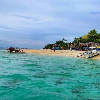 Just a simple white sand beach in Moalboal, Cebu. 💦 Travelwithjai Travelporn Wanderlust TravelAndFoodNotes intoCebu SandSeaSky