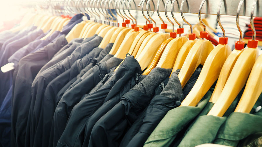 Close-Up Of Clothes Hanging On Rack In Store For Sale