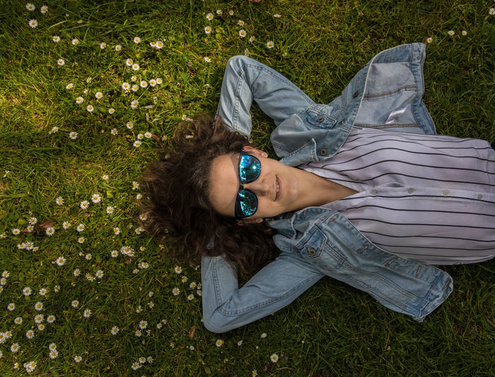 High angle portrait of woman relaxing on land