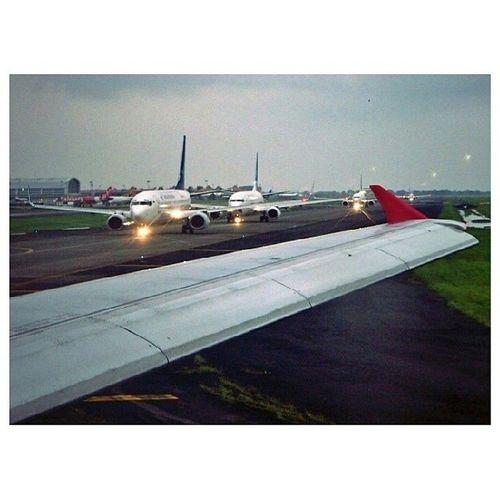 Hazymorning B737 Garudaindonesia Taxiing behind a320 airasia aircraft airport rain jakarta indonesia soekarnohatta