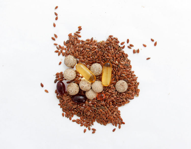 flax seeds and omega 3 Capsules Close-up Cod Liver Oil Flax Flax Seeds Food Halthy Medicine No People Omega 3 See Supplements White Background
