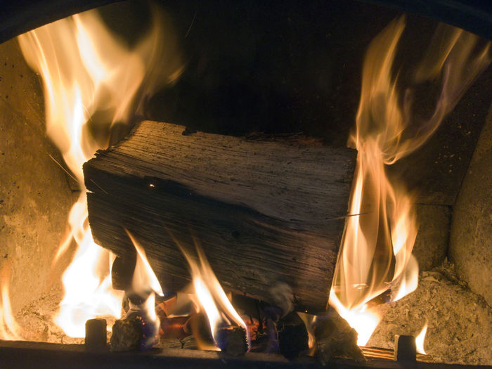 Close-Up Of Wood Burning In Fireplace