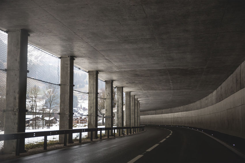 Mountain underpass Architectural Column Architecture Built Structure Column Corridor Day Diminishing Perspective Empty Illuminated Long Modern Narrow No People Road Sky The Way Forward Tunnel Vanishing Point