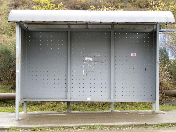 Closed metal gate on footpath in field