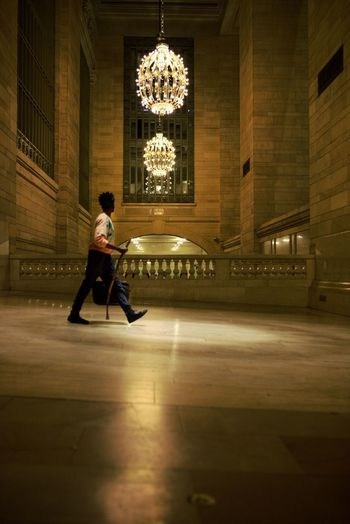 Man Walking Against Chandeliers At Grand Central Station