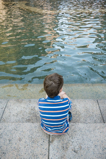 Fountain Steps Boy Boys Child Childhood Children Only Day Full Length High Angle View Leisure Activity Nature One Boy Only One Person Outdoors People Real People Rear View Sitting Striped Water