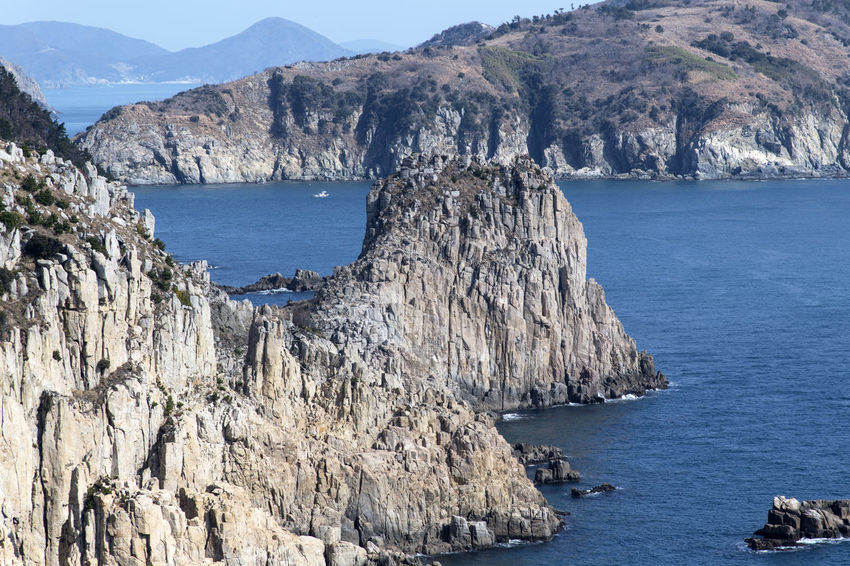 seaside view of Deungdaeseom Island (lighthouse island) by Somaemuldo in the sea of Tongyeong, Gyeongnam, South Korea. Deungdaeseom Nature's Beauty Nikon D850 Tongyeong Tranquility Beauty Of Nature Bright Day Cliff D850 Island No People Outdoor Outdoors Peaceful Day Peaceful Nature Sea Sea Cliff Sea Rocks Seaside Seaside Cliff Seaside View Somaemuldo Tranquil Scene View From Island