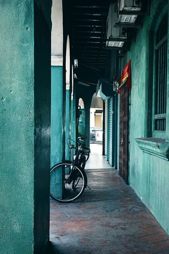 Back in Penang. Bicycle Architecture Cycling Built Structure Transportation Building Exterior Outdoors No People Day Urban Photography SonyAlpha6000 Outings  Travel 50mm From Where I Stand Cold Temperature Urban Culture Old Bicycle Old Town Roadtrip Tones Of Colour Blue Tones Green Tone EyeEmNewHere Adapted To The City Lieblingsteil Miles Away Uniqueness