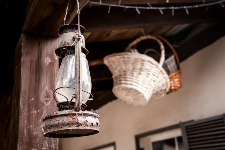Low angle view of lanterns hanging on roof