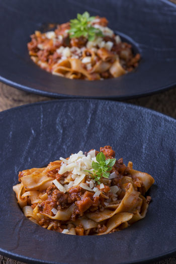 Bologne Tagliatelle Bolognesesauce Close-up Dinner Focus On Foreground Food Food And Drink Freshness Healthy Eating Herb High Angle View Indoors  Indulgence Italian Food Kitchen Utensil Meal Meat No People Pasta Plate Ready-to-eat Still Life Table Temptation Tray Vegetable