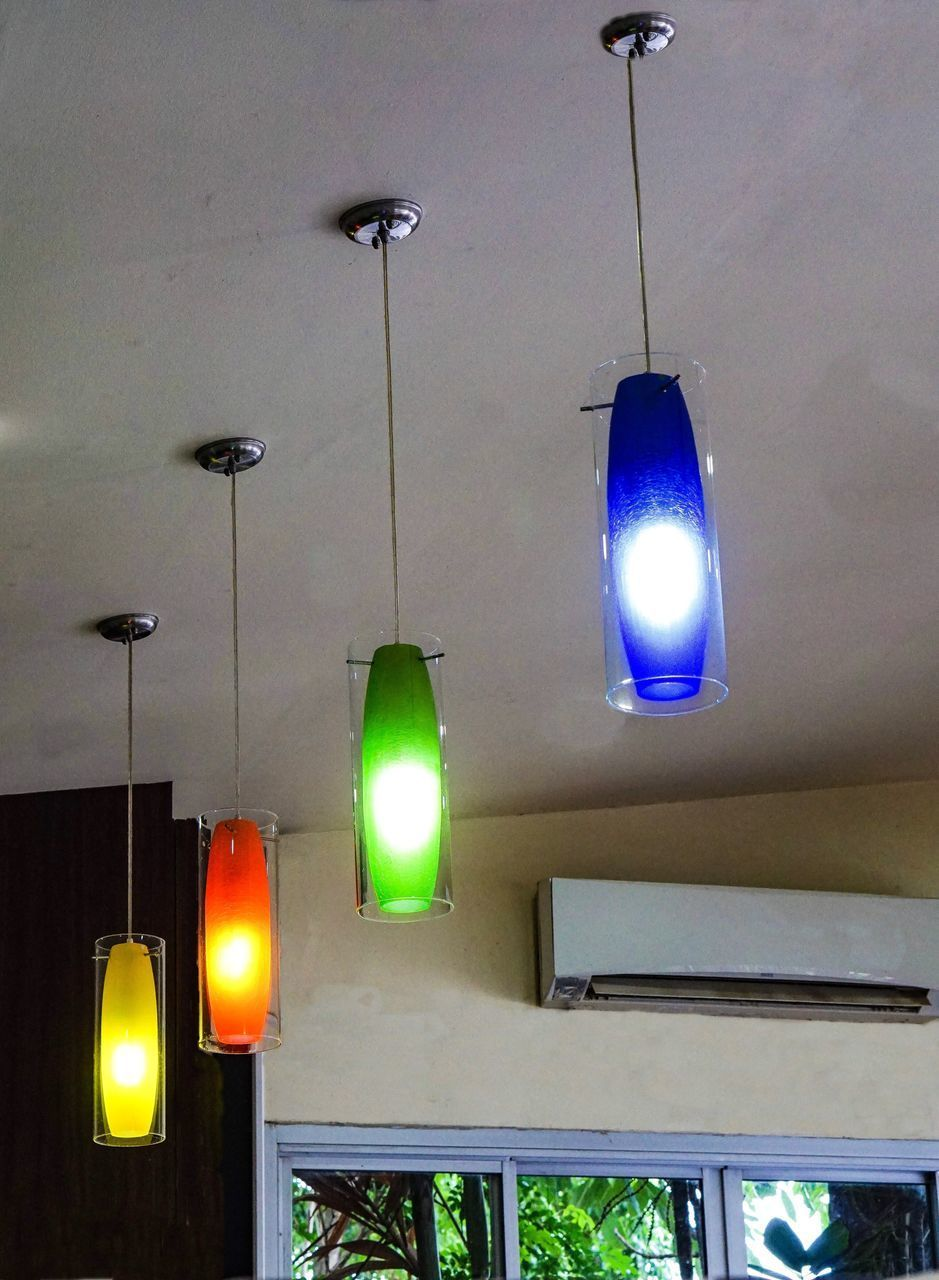 LOW ANGLE VIEW OF ILLUMINATED LIGHTING EQUIPMENT HANGING AT CEILING