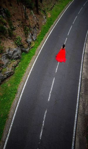 'Untitled' Road Transportation Marking Symbol Sign Road Marking Visual Creativity Red High Angle View The Way Forward Asphalt One Person Outdoors The Creative - 2018 EyeEm Awards