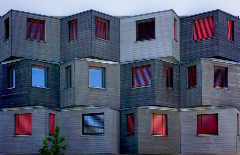 colorful windows Building Exterior Architecture Built Structure Building Window No People City Day Low Angle View Sky Outdoors Pattern Modern Glass - Material Residential District Brick Red Design Blue Apartment Colorful Full Frame