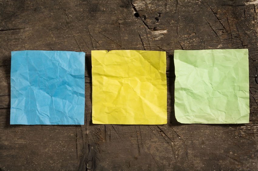 Three crumpled blank note papers in different colors on a wooden surface To Do List Writing Adhesive Note Backgrounds Blank Board Brown Close-up Communication Copy Space Crumpled Ideas Information Message Note Old Paper Pattern Plank Reminder Table Textured  Wood Wrinkled Yellow