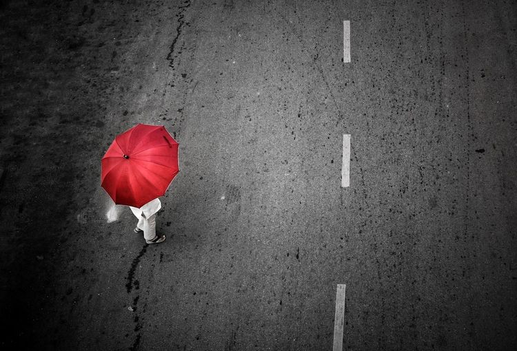 High angle view of red umbrella on street