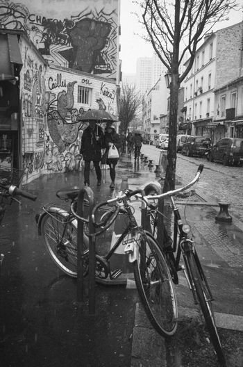 Bicycles on wet street in city
