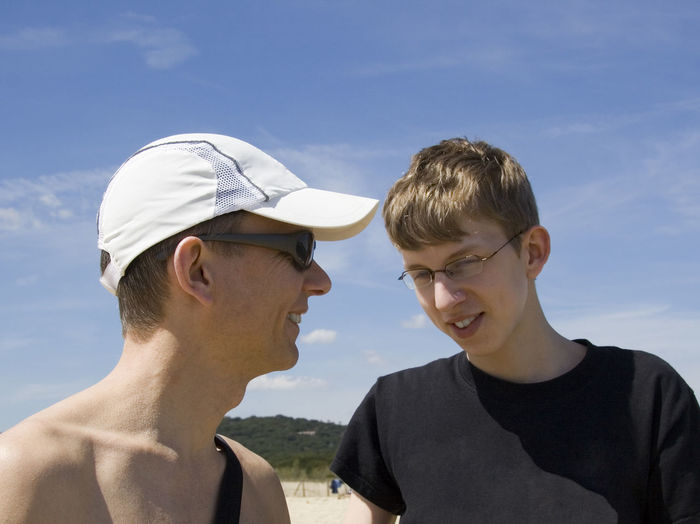 father and son - enjoying vacations Beach Boy Cap Close-up Family Father Father & Son Fatherhood Moments Glasses Happiness Happy Headshot Leisure Activity Mid Adult Men Portrait Real People Smiling Son Summer Teen Teenage Boy Teenager Togetherness Two People Vacations