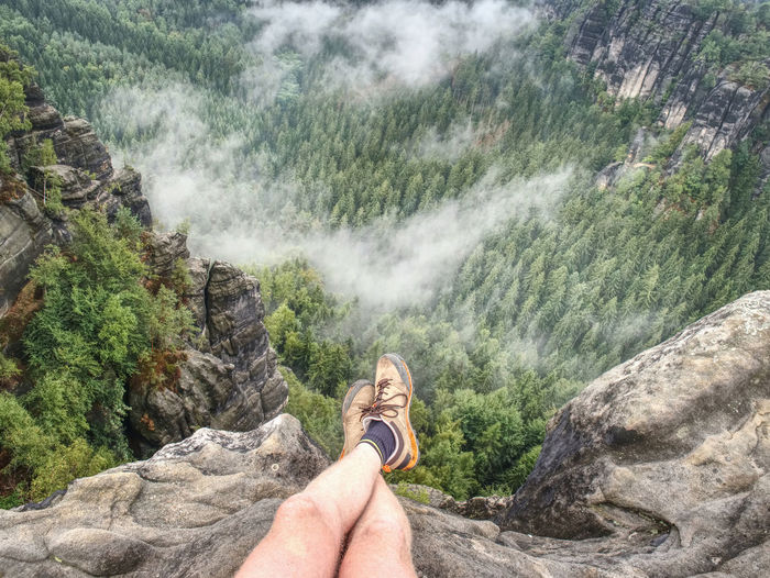 Reached summit of mountain peak. climbing and hiking sport concept. tourist take a rest