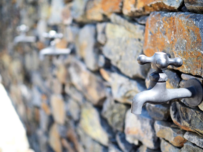 A faucet attached to the rock wall (岩の壁に付いた蛇口) Ad Beautiful Copy Space Daytime Japan Black Color Brown Close-up Faucet Faucet On The Wall Faucets Gray Landscape Margin No People No Person Nobody Outdoors Rock Rock - Object Stone Material Stone Wall Text Space Wall White