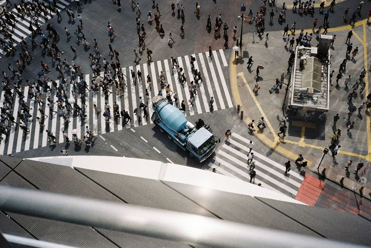 High angle view of crowd crossing road