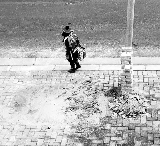 Child walking home from school Bini Backpack Sidewalk Walking On Uneven Road Bricks Stacked Up Against Street Light Child Walking Home From School Full Length Real People Day Men Walking Working #urbanana: The Urban Playground One Person Street Outdoors High Angle View