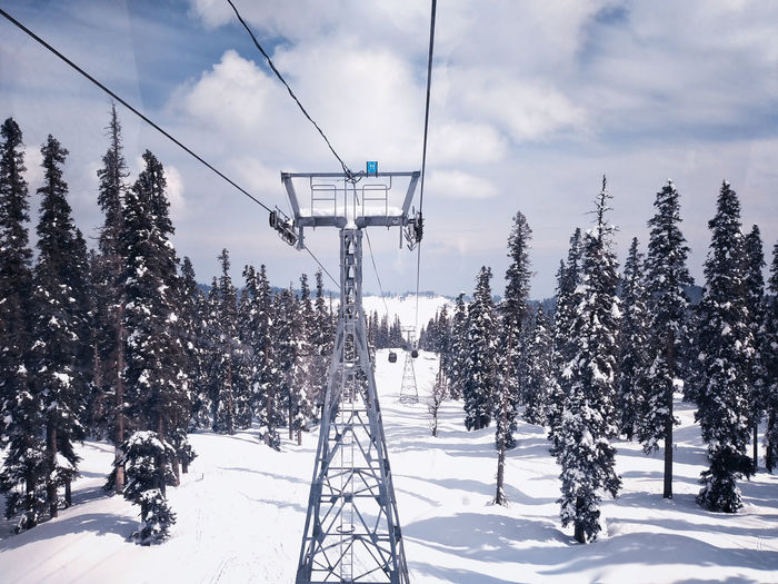 Electricity  Snowcapped Mountain Outdoors Cable Day White Color No People Land Ski Lift Tranquility Cable Car Scenics - Nature Cloud - Sky Tranquil Scene Nature Beauty In Nature Sky Plant Tree Cold Temperature Snow Winter Covering Sky Resort Cable-stayed Bridge Cables And Wires