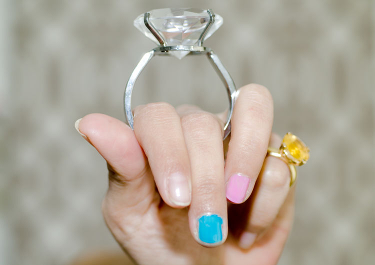 Close-up of woman holding huge ring