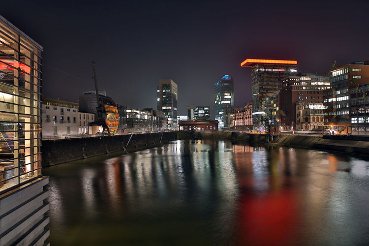 Dusseldorf media harbor district at night with modern office buildigs