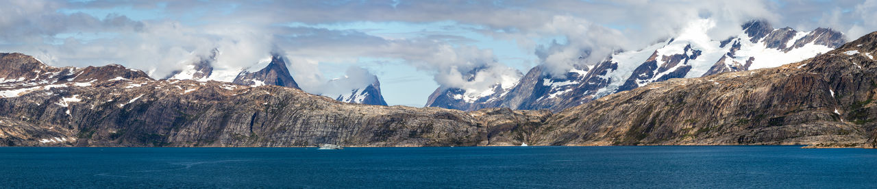 Iceberg at the skjoldungen fjord, a coastal island in the southeastern shores of greenland.
